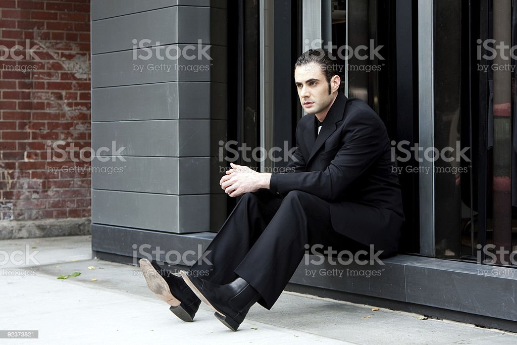Business man sitting royalty-free stock photo