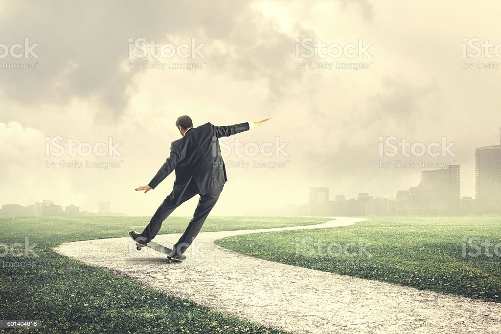 business man skater going fast to the office stock photo