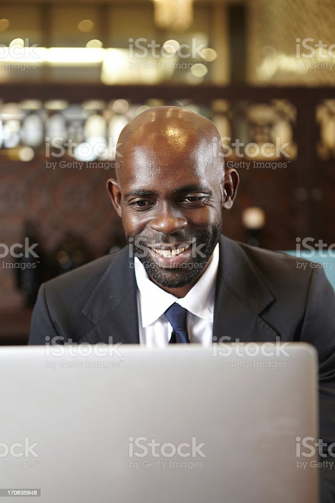 Business Man smiles as he reads an email royalty-free stock photo