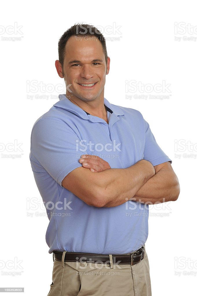 Business man smiling at camera with arms crossed on chest royalty-free stock photo