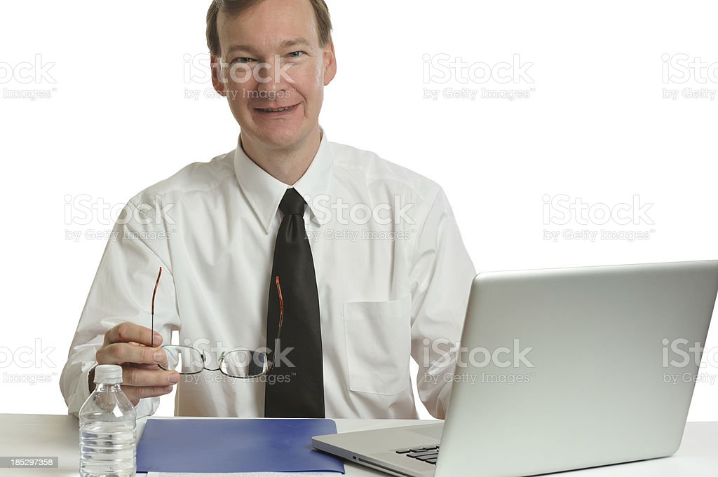 Business man smiling in his office royalty-free stock photo