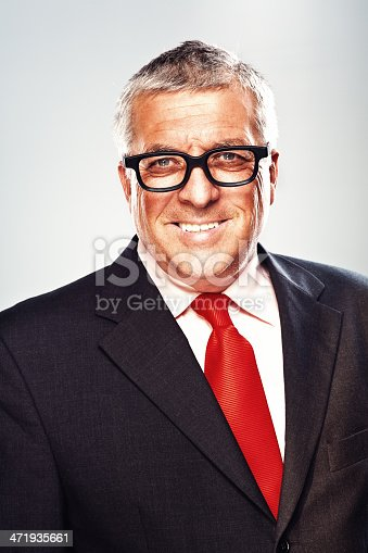 825083248istockphoto Business man smiling 471935661