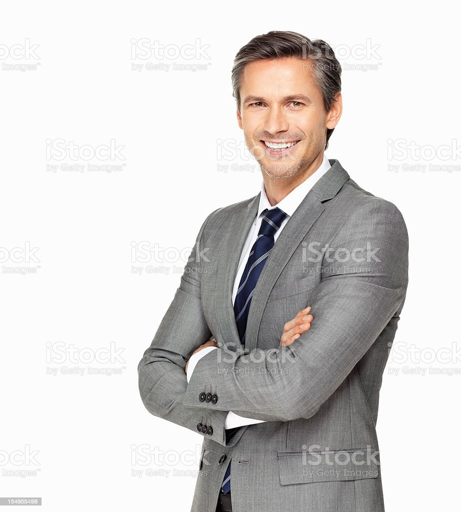 Business man smiling with arms crossed stock photo