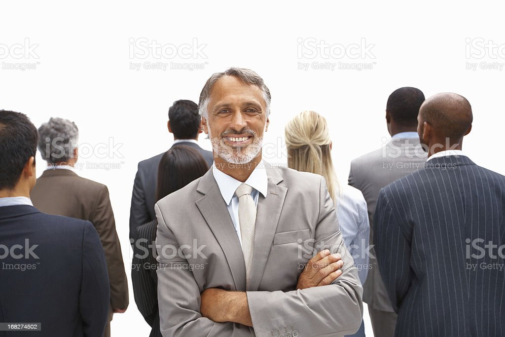 Business man smiling with colleagues in background royalty-free stock photo