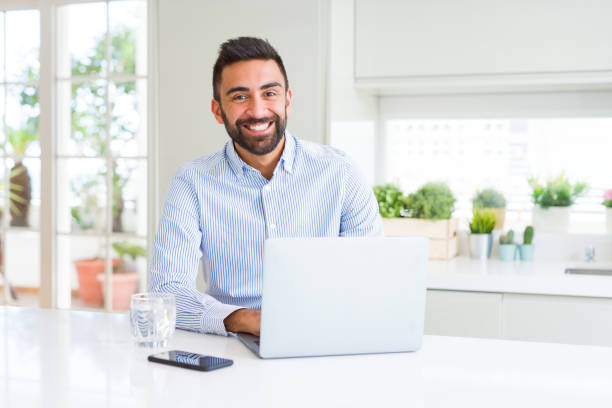 Business man smiling working using computer laptop Business man smiling working using computer laptop spanish and portuguese ethnicity stock pictures, royalty-free photos & images
