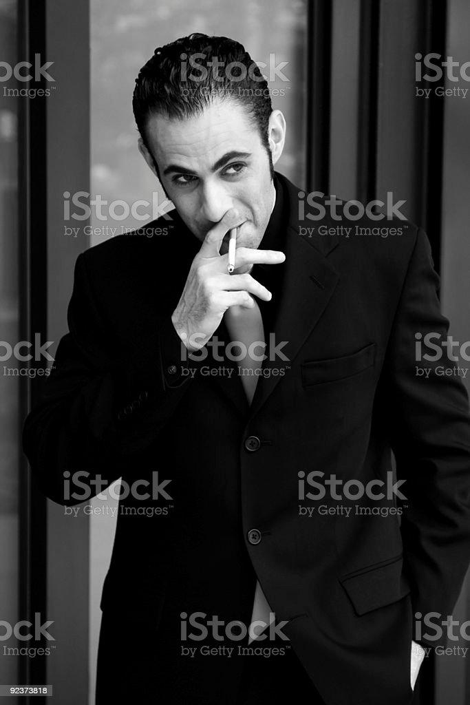 Business man smoking royalty-free stock photo