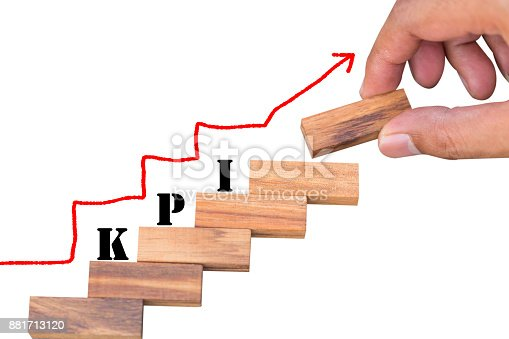 istock Business man stacking level of wooden block with KPI word and raise arrow, working and goal concept. 881713120