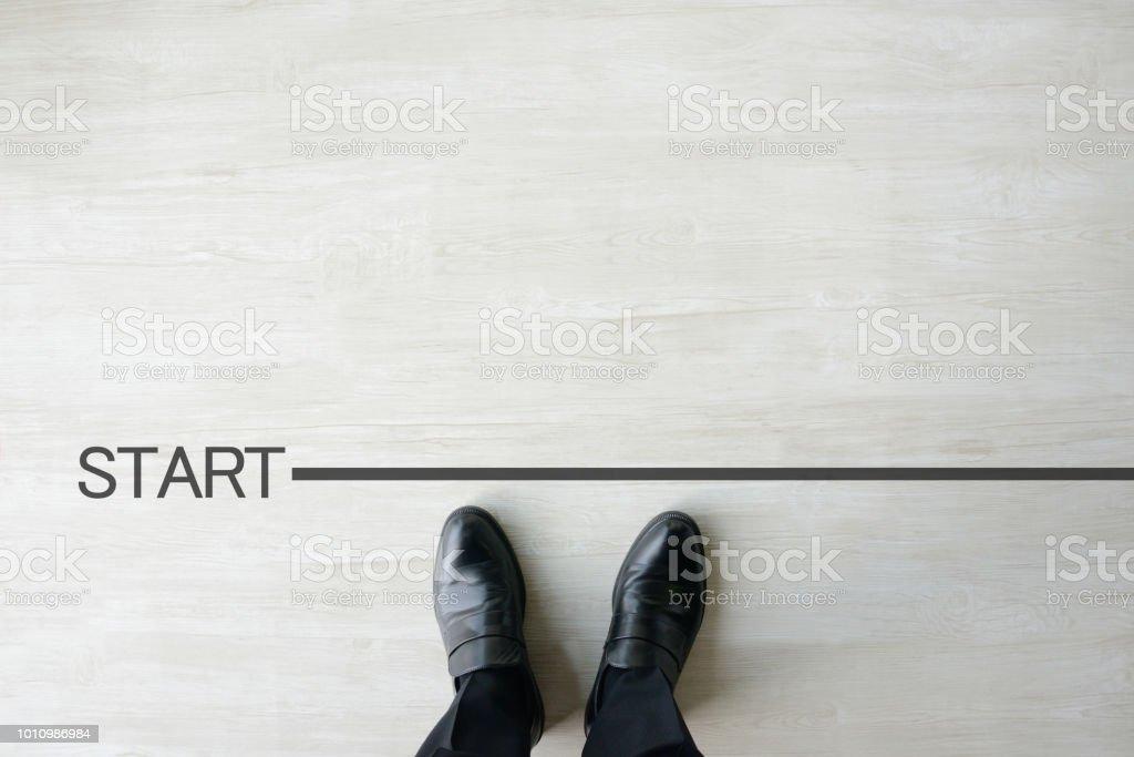 Business man standing of start line stock photo