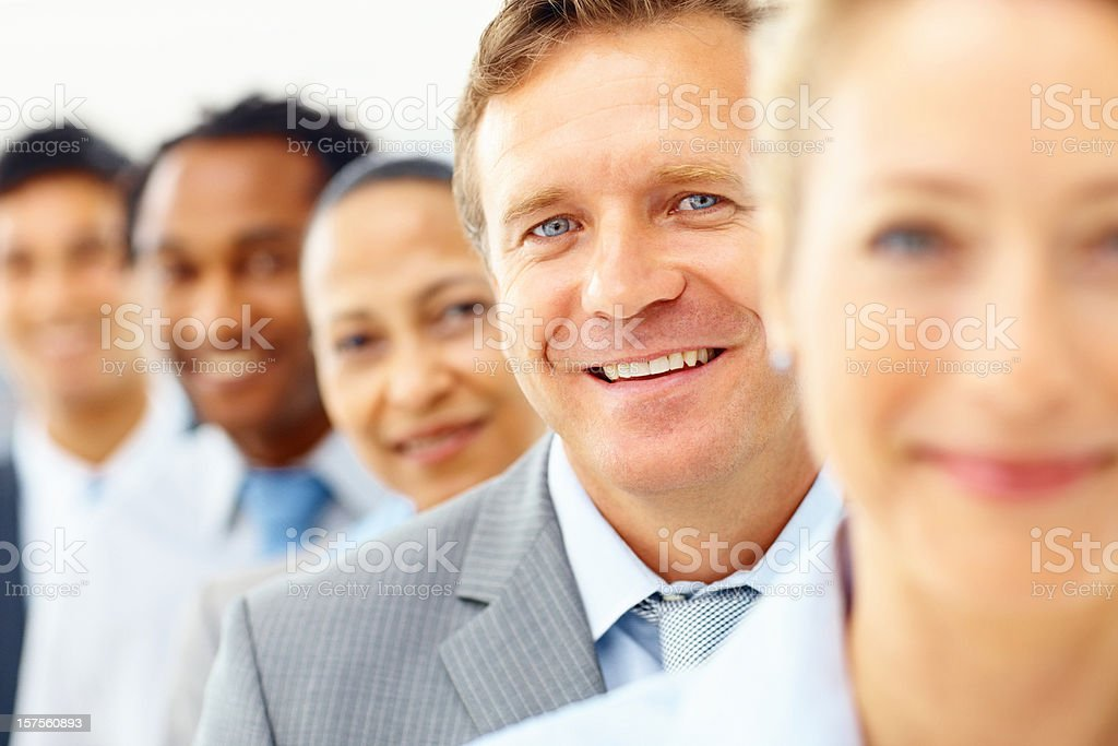 Business man standing wirh colleagues in a row royalty-free stock photo