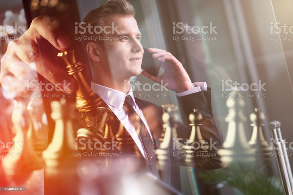 business man strategy brainstorm chess board game with hand touch...