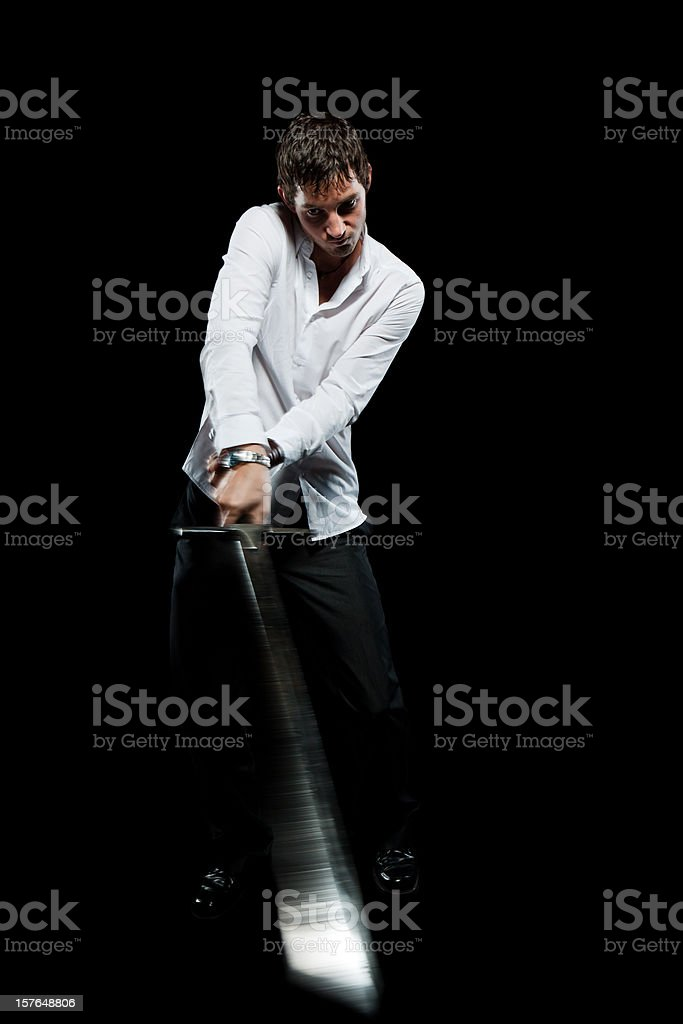Business Man Striking with a Sword royalty-free stock photo
