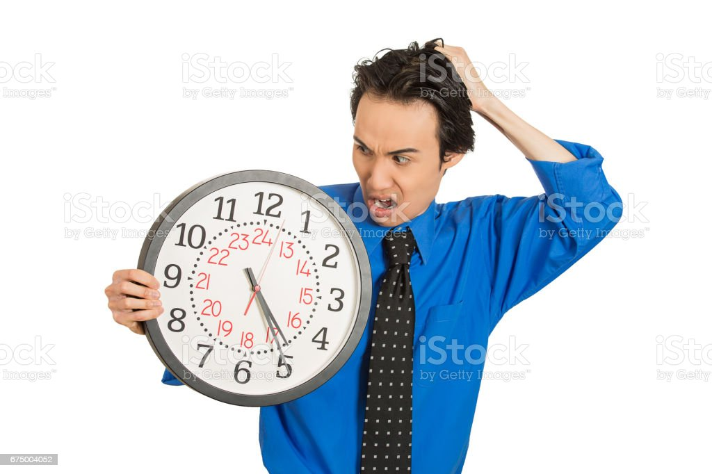 business man, student, leader holding wall clock very stressed, pressured by lack of running out of time late for meeting stock photo