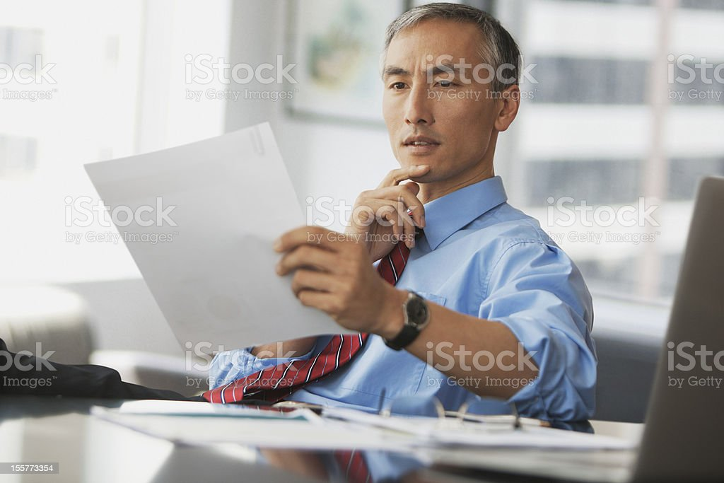Business man studying report royalty-free stock photo