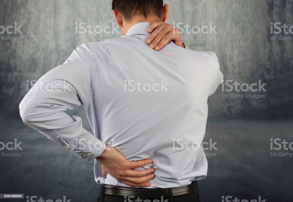 Business man suffering from neck and back pain stock photo