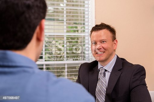 1129638619 istock photo Business: Man talks with his lawyer or financial advisor. 497568497