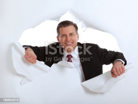 istock Business Man Tearing Through Paper 183834613