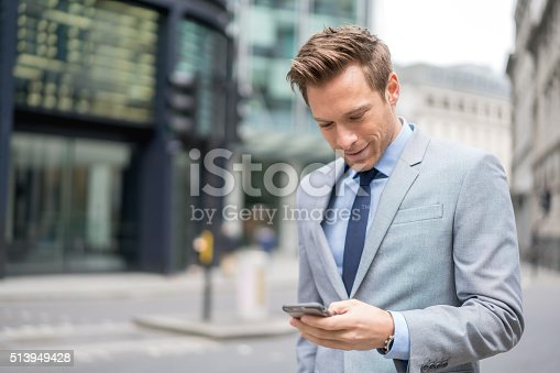 istock Business man texting on his phone 513949428