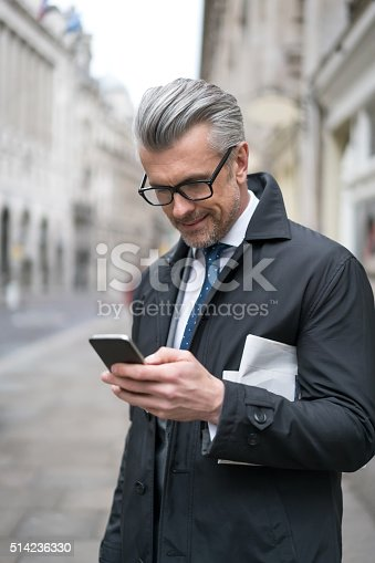 istock Business man texting on his phone 514236330
