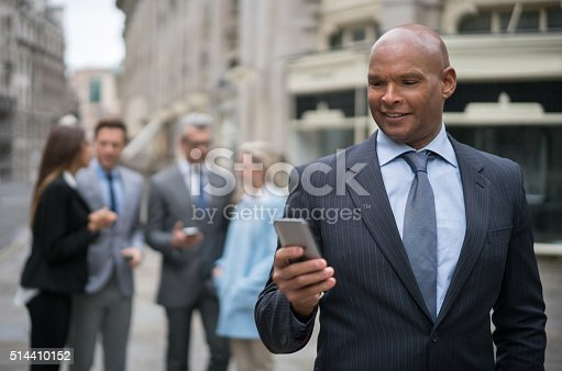 istock Business man texting on his phone 514410152