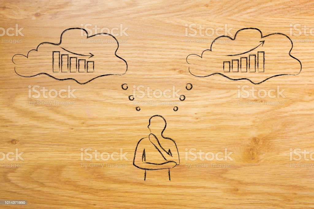 business man thinking about decisions that can lead to growth or decline stock photo