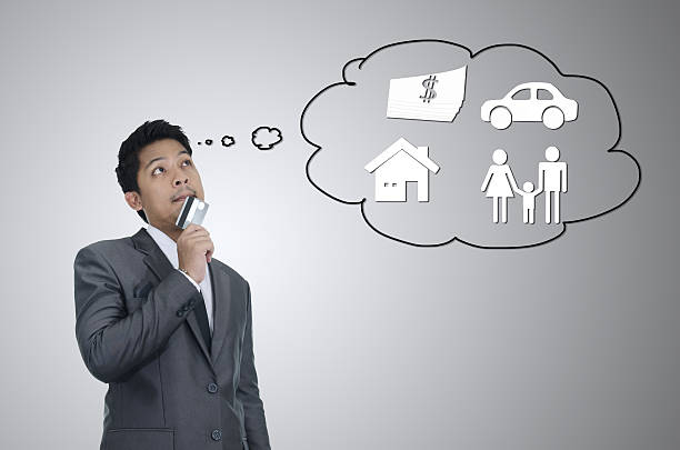 Business man thinking for secure family concept wit credit card stock photo