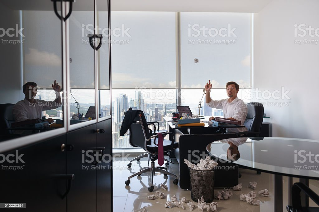 Business Man Throwing Paper Letter To Trash Bin stock photo