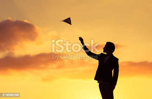 istock Business man throwing paper plane 519388266