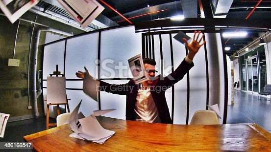 157312920 istock photo Business man throwing paperwork in frustration 486166547
