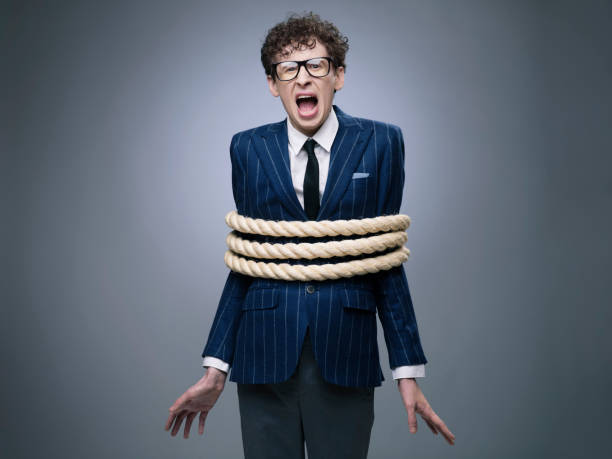 business man tied up with rope - tangled stock photos and pictures