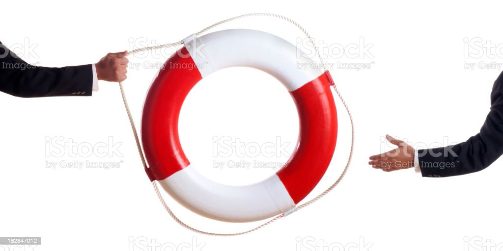 Business Man Tossing a Life Preserver stock photo