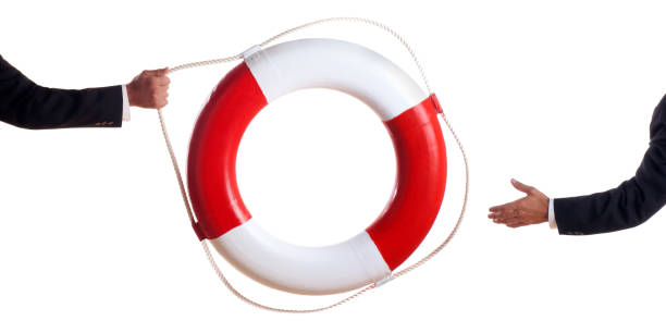 "Business Man Tossing a Life Preserver ""This is a conceptual photo relating to businesses and bailouts, etc.Click on the links below to view lightboxes."" bailout stock pictures, royalty-free photos & images"