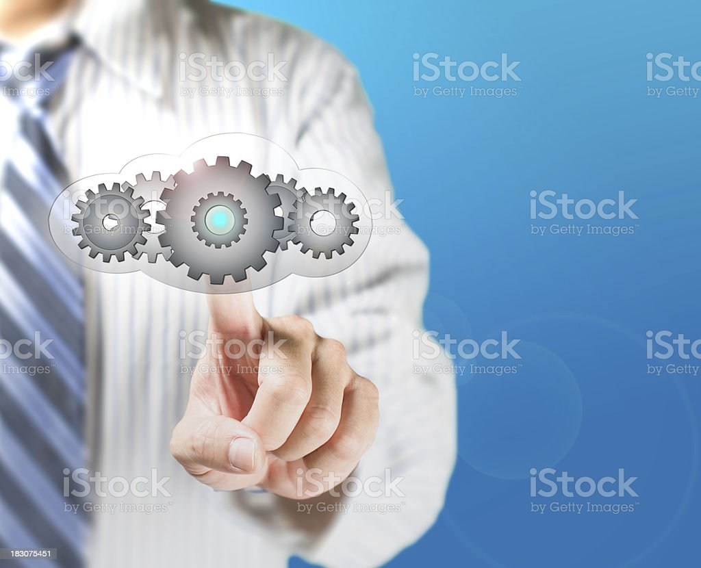 Business man touch cloud with gears inside for launching royalty-free stock photo