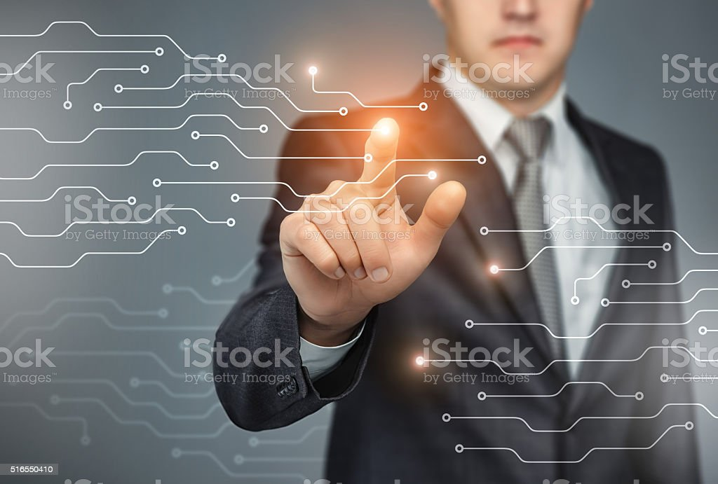 Business man touch digital icons and charts on the holographic stock photo