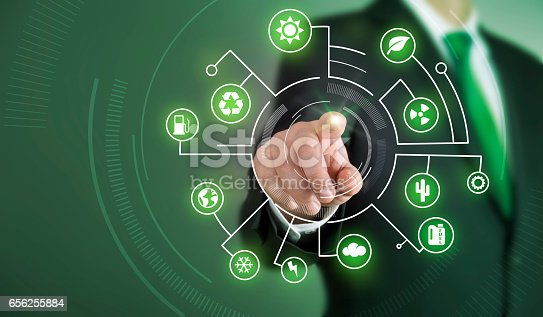 istock Business man touch screen concept - Green 656255884