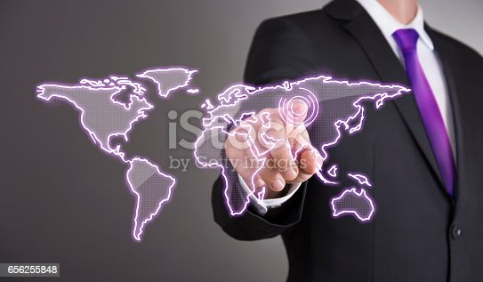 823686896 istock photo Business man touch screen concept - World 656255848