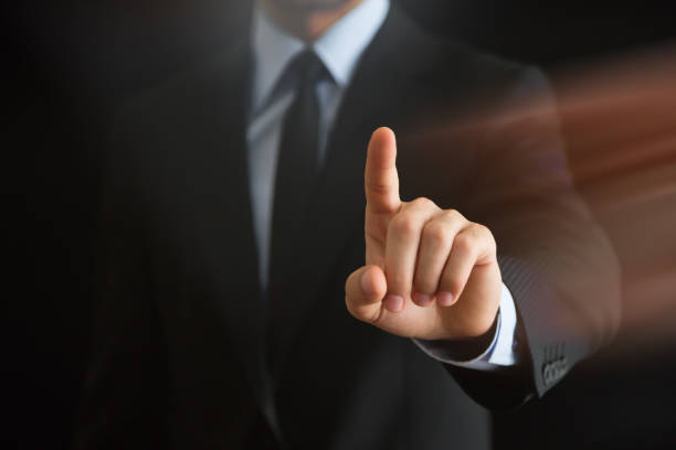 business man touching imaginery screen - finger point stock photos and pictures