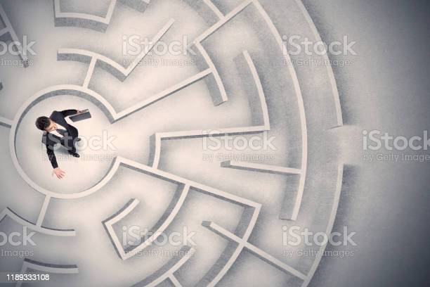 Business man trapped in a circular maze picture id1189333108?b=1&k=6&m=1189333108&s=612x612&h=8izvgw3vato x62ywn haapqlref 6my4y 6f6wn 44=