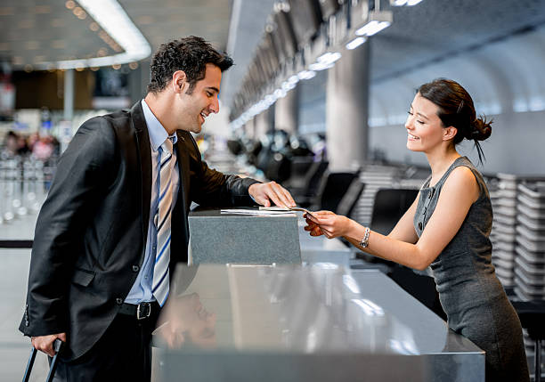 business man traveling - airport check in counter stock pictures, royalty-free photos & images