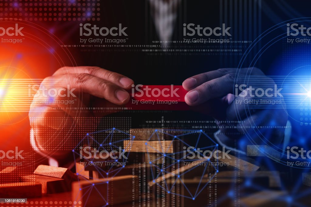 business man try to build wood block on wooden table and black background business organization startup concept stock photo