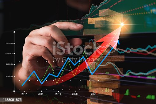 istock business man try to choose red color wood block from others on wooden table and black background business organization startup conceptackground business organization startup concept 1133081875