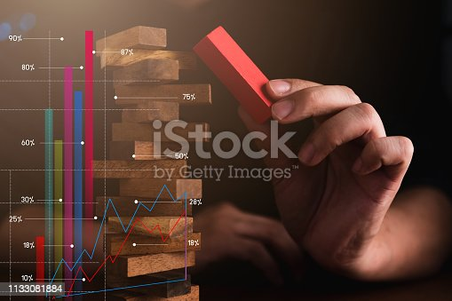 istock business man try to choose red color wood block from others on wooden table and black background business organization startup conceptackground business organization startup concept 1133081884