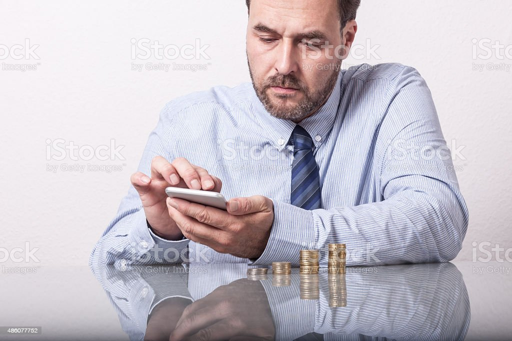Business man typing on smart phone stock photo