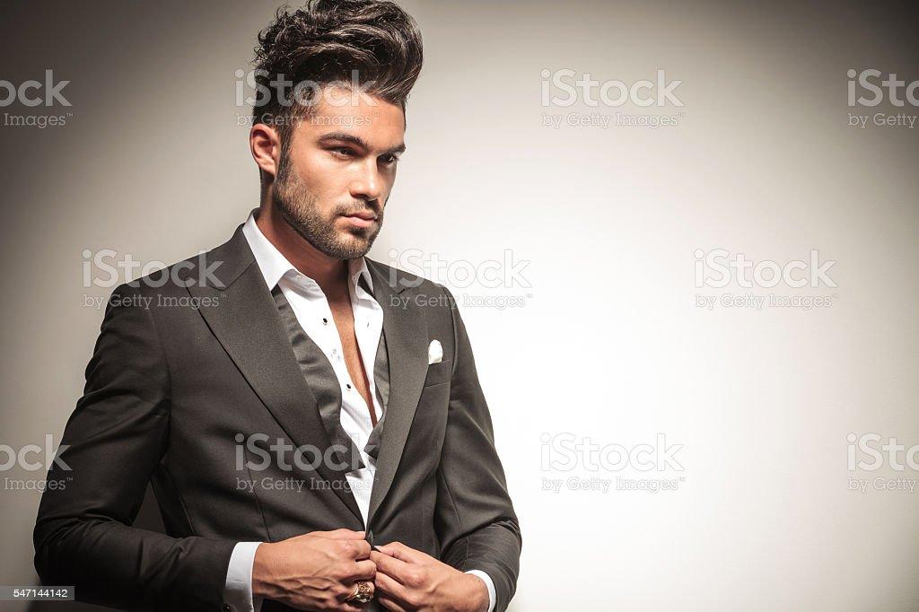 business man unbuttoning his jacket stock photo