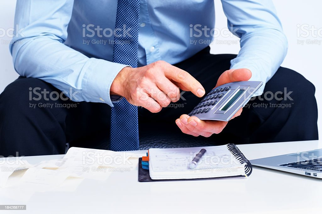 Business man use calculator on white background royalty-free stock photo