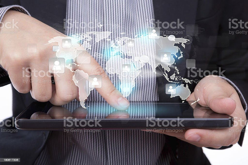 Business man using a touch screen device with social network royalty-free stock photo