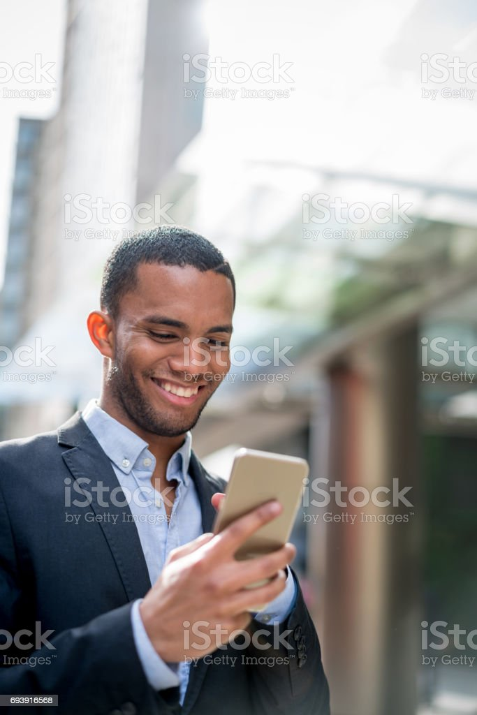 Business man using app on his mobile phone stock photo