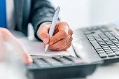 istock Business man using calculator 1086691530