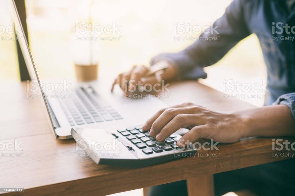 Business man  using calculator. stock photo