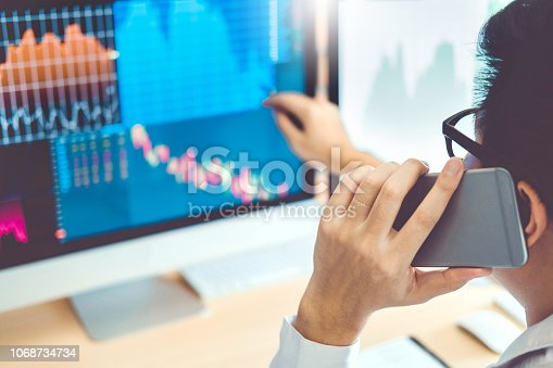istock Business Man Using Mobile phone Investment discussing and analysis graph stock market trading,stock chart concept 1068734734