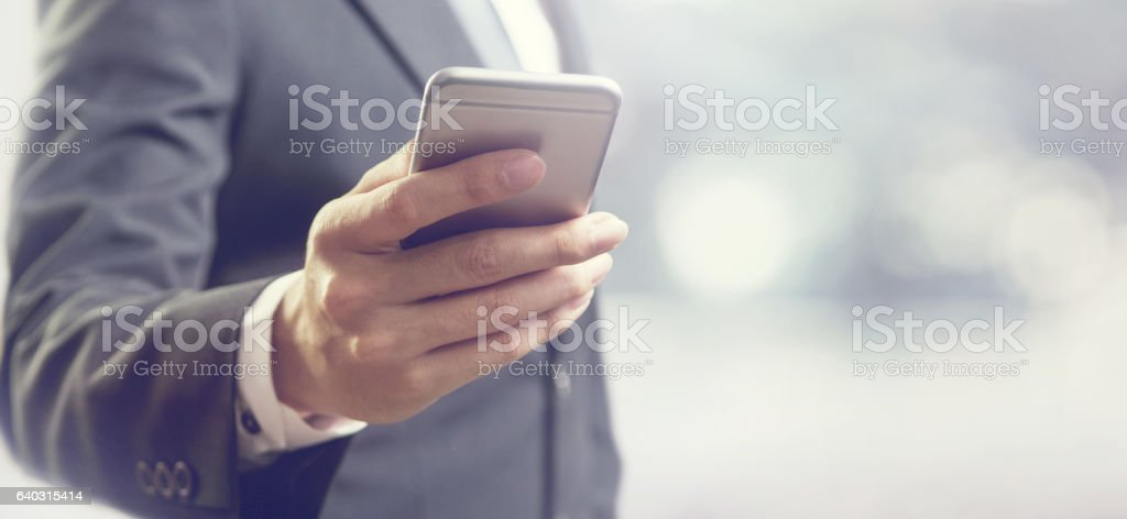 business man using mobile smart phone stock photo